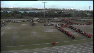 "Students form ""MDS"" on field in memory of shooting victims"