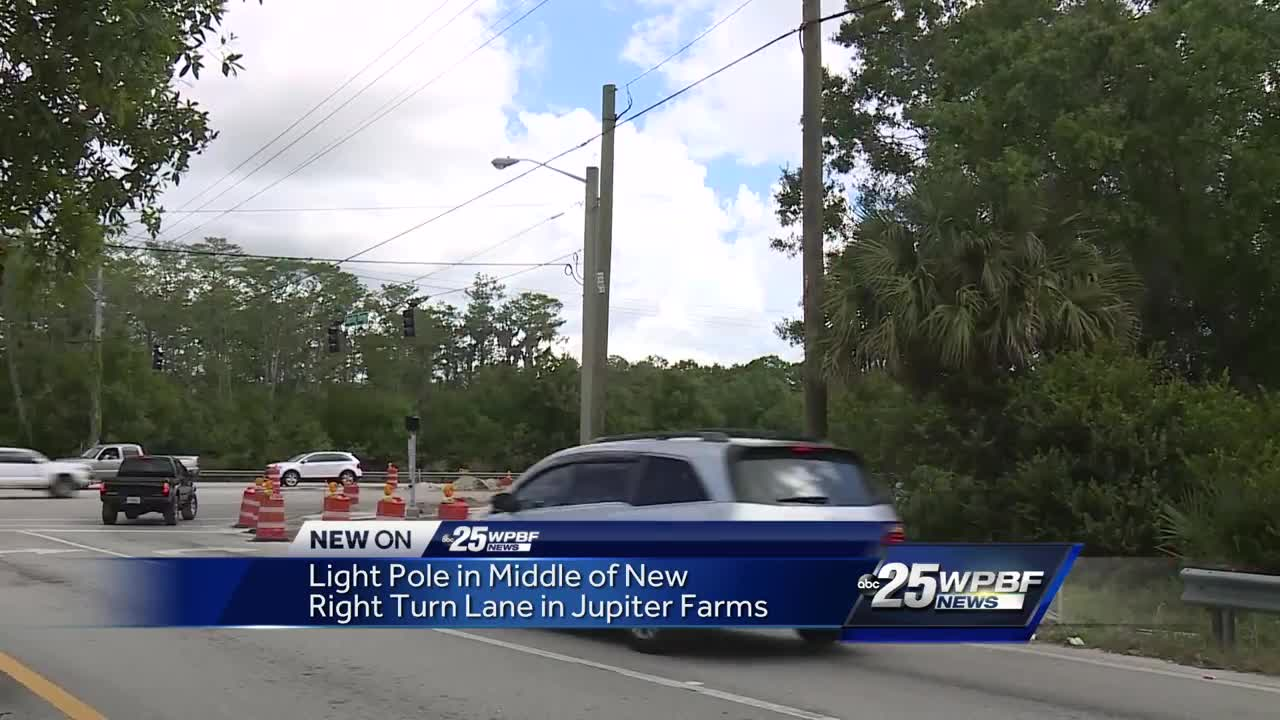 Light pole in middle of new right turn lane in Jupiter Farms