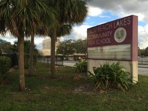 School police: Former student shows gun