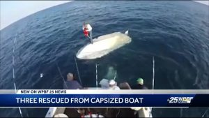 Three rescued from capsized boat