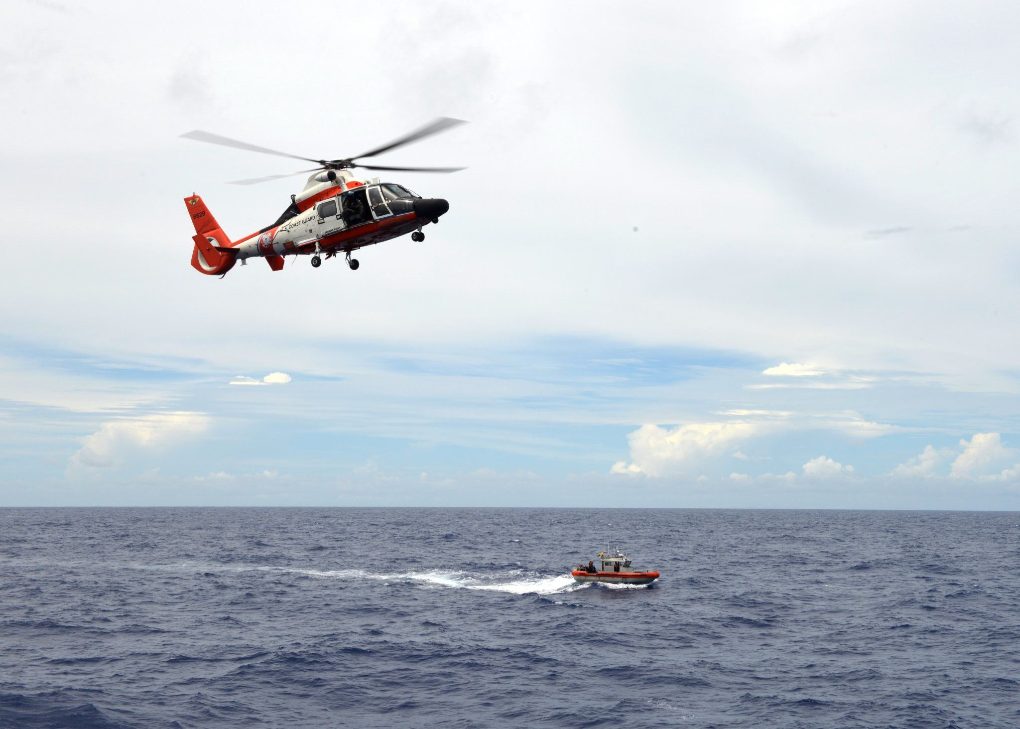 Coast Guard continues search throughout night for 2 people