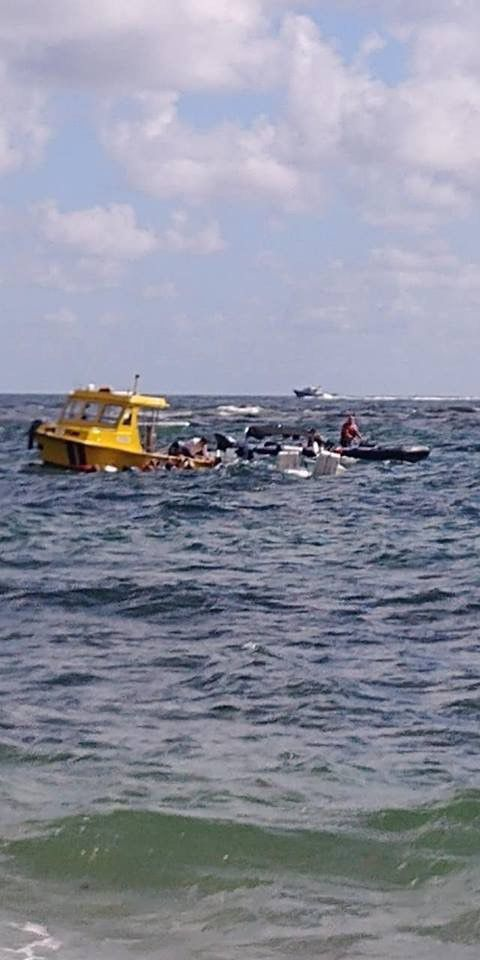 15 people rescued after big wave swamps boat coming into Boynton Beach Inlet