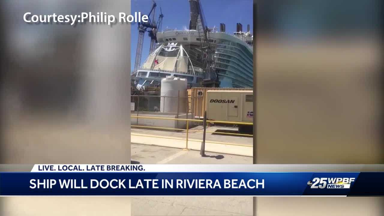 Local cruise ships help crew members on ship damaged by crane