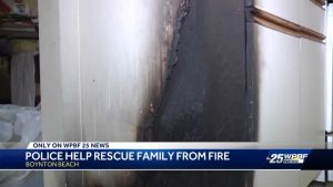 Boynton Beach police officers rush into burning home to save family of four