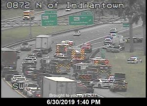 Man pulled from submerged vehicle off I-95 near the Indiantown exit ramp