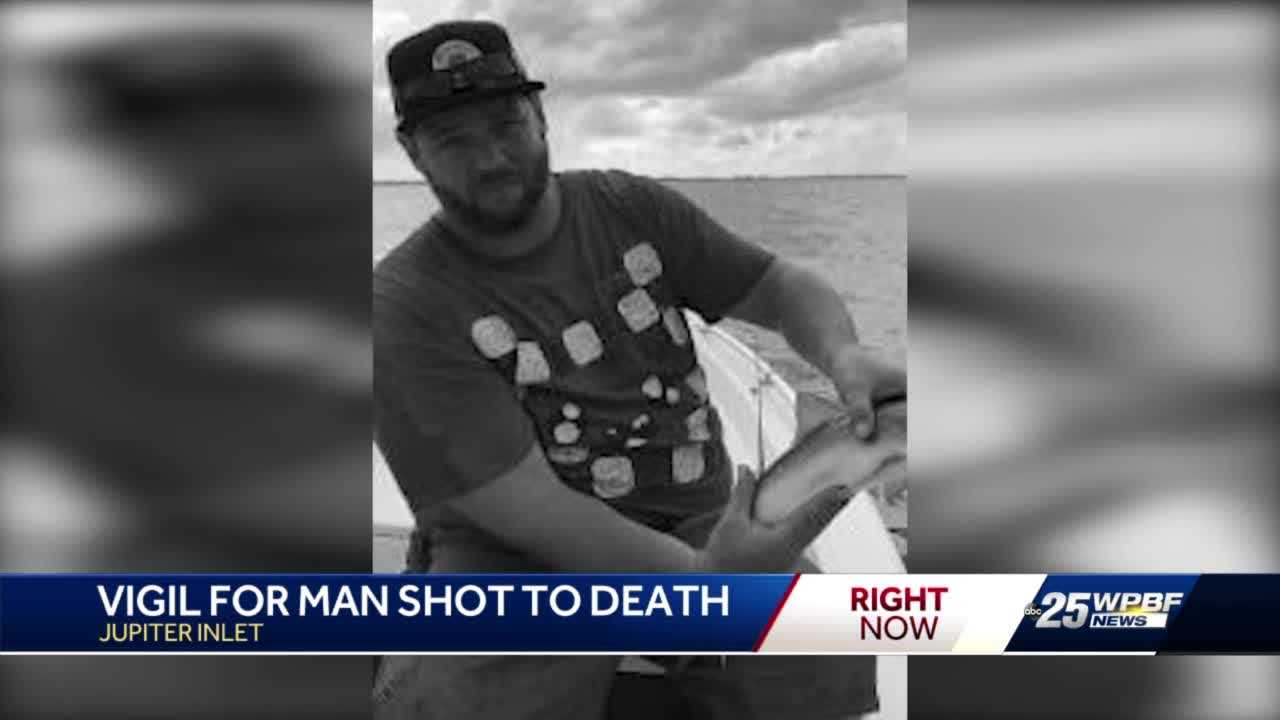 Vigil for man shot to death while protecting woman from her boyfriend