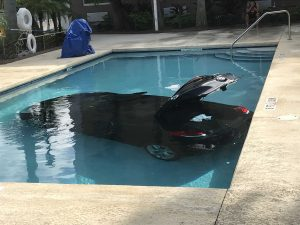 Car crashes into hotel pool in West Palm Beach
