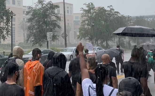 Protesters brave heavy rain and lightning to make voices heard in West Palm Beach