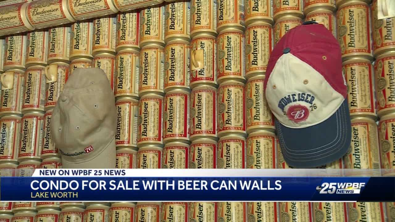 Condo with walls lined with Budweiser beer cans on sale