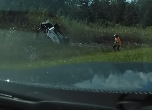 WPBF Exclusive video: Driver saves people from sinking car along Beeline Hwy