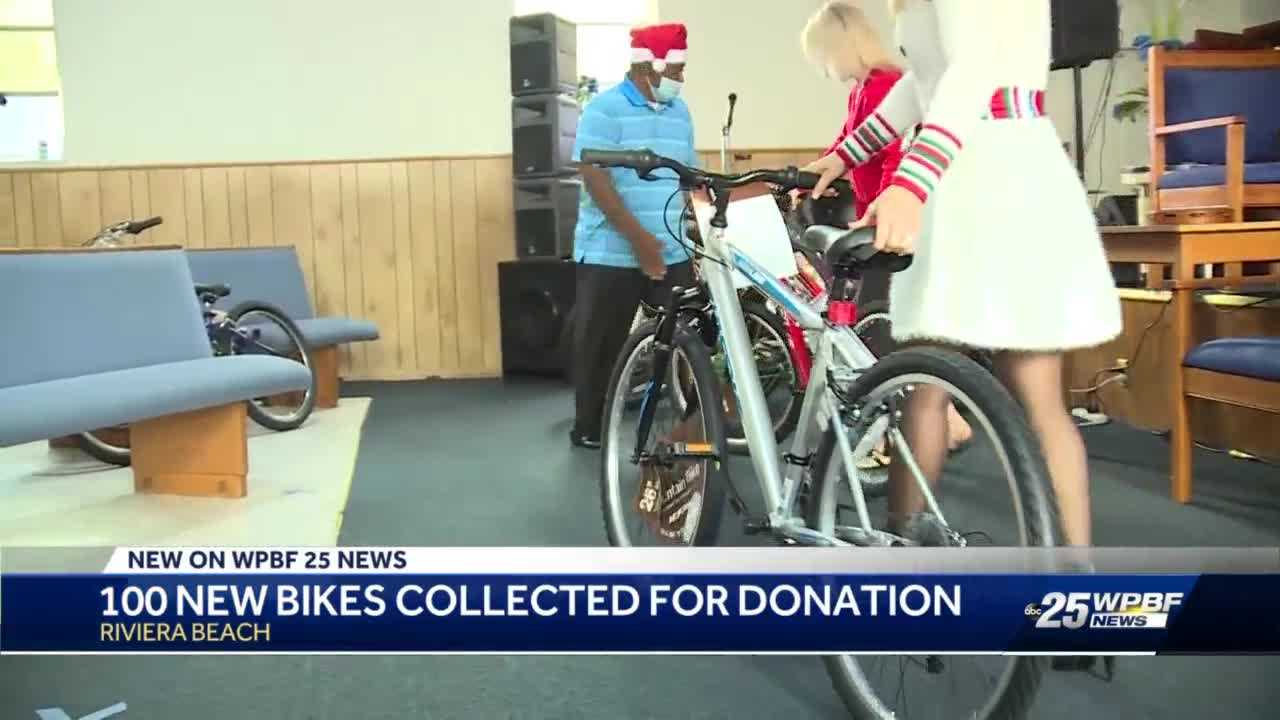 100 local children receiving free bicycles on Christmas Day