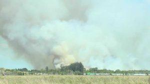 460-acre brush fire burning in Palm Beach Gardens