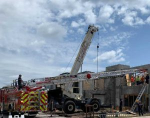 One person rescued from construction site roof in Boca Raton